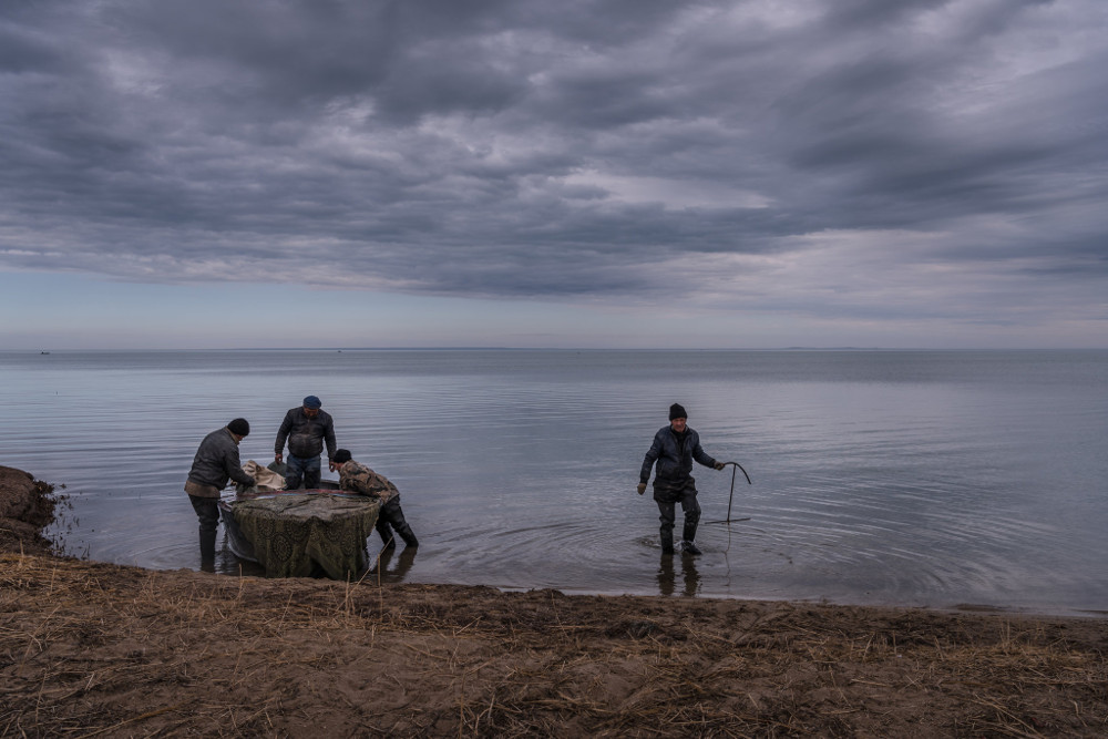 Fishermen in Kazakhstan. By building a dam, the country rejuvenated what is sometimes called the Small or North Aral Sea, with 100 feet of water in places. Fish, having once vanished, now flourish. Sergey Ponomarev for The New York Times