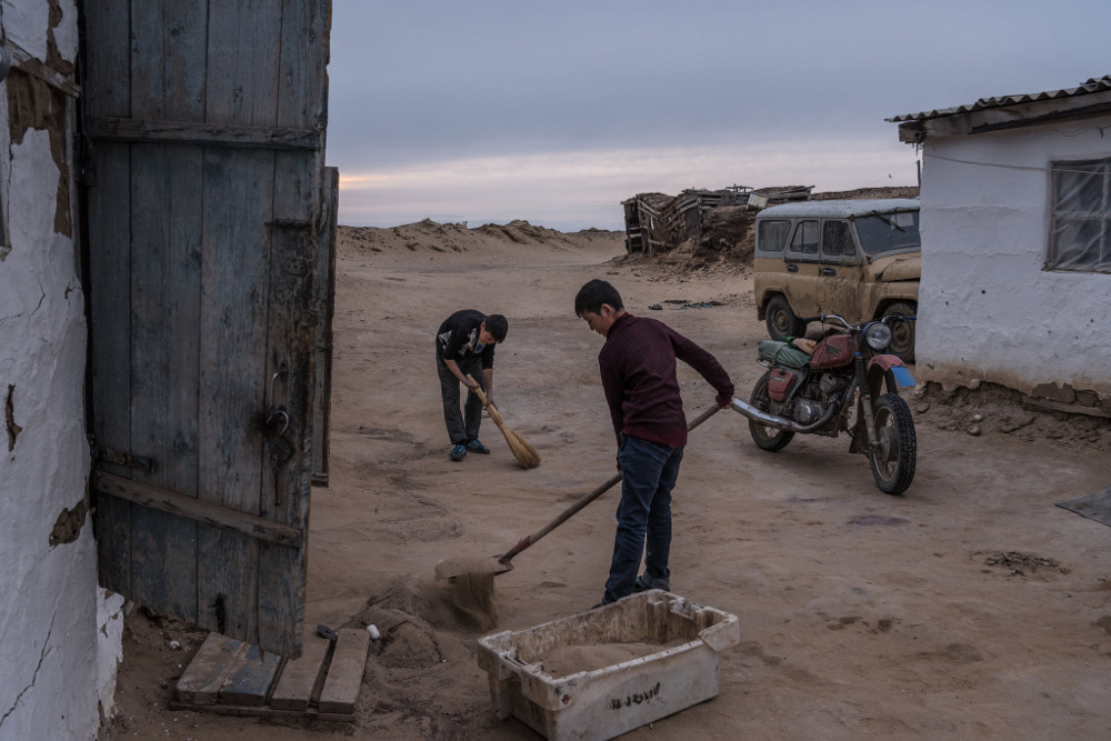 In the almost abandoned village of Akespe, Kazakhstan, residents must remove the sand brought by the wind each day. Sergey Ponomarev for The New York Times