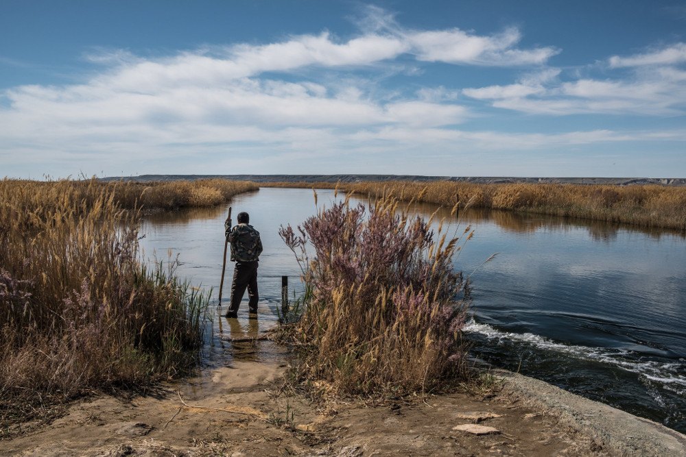 Fishing at the Sudochye Lake, which was once part of the Aral Sea in Uzbekistan. Sergey Ponomarev for The New York Times